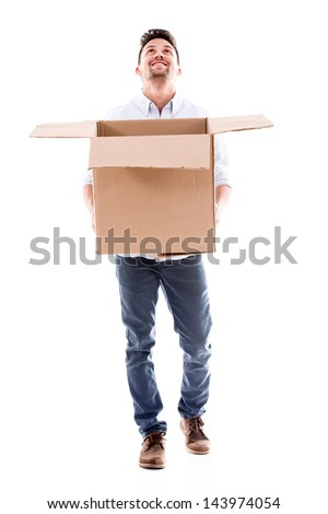 Happy man holding a box catching something - isolated over white