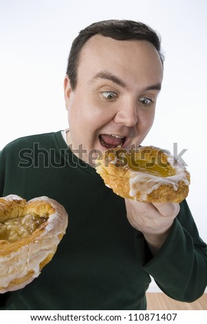 Happy Man Holding A Donut