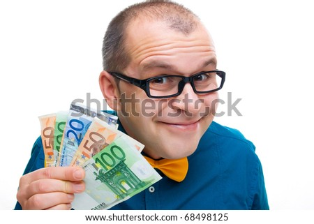 Happy man holding european money isolated on white - stock photo