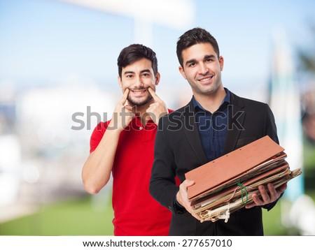 happy man holding files - stock photo