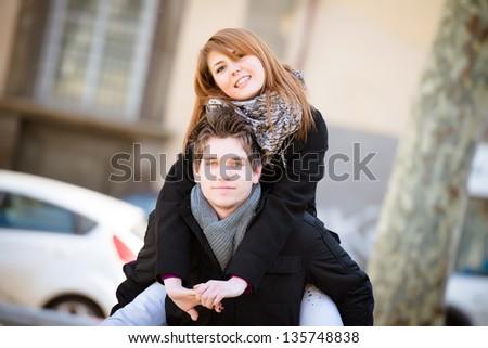Happy Man Holding his Girlfriend Piggyback,Italy - stock photo