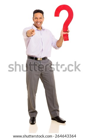 happy man holding question mark and pointing at the camera - stock photo