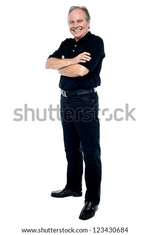 Happy man in black attire posing with arms folded. Full length on white. - stock photo