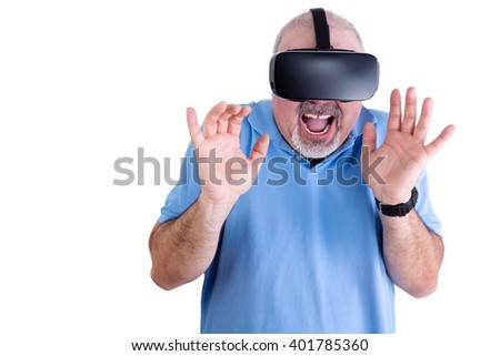 Happy man in blue polo shirt and virtual reality glasses screams while holding his hands up