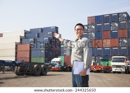 happy man in front of container truck - stock photo