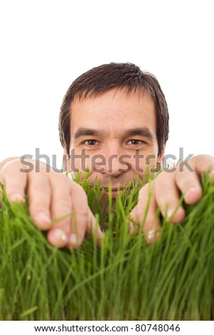 Happy man in green grass - environment concept, isolated - stock photo