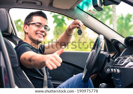 happy man in his car - stock photo