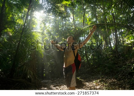 happy man in the jungle, freedom oncept - stock photo