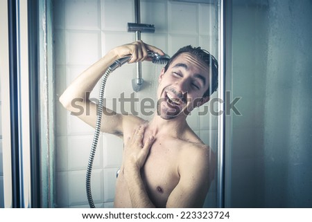 Happy man in the shower  - stock photo
