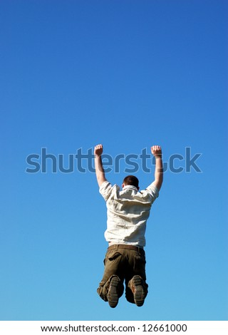 happy man jumping on sky background
