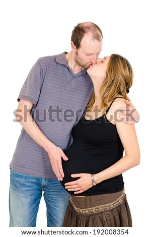 Happy man kissing and embracing beautiful pregnant woman isolated on white background - stock photo
