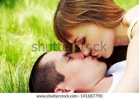 Happy man kissing his girlfriend outdoor