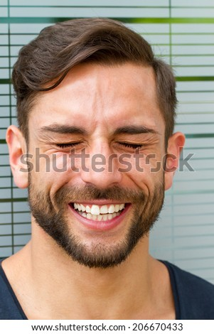 Happy man laughing