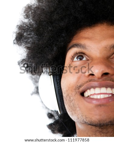 Happy man listening to music with headphones - isolated over a white background - stock photo