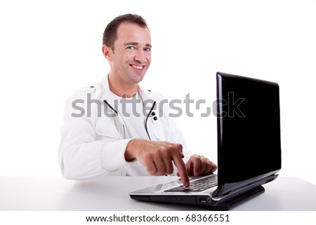 happy man looking to camera, put the finger on computer, isolated on white background. Studio shot. - stock photo