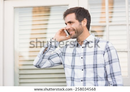 Happy man on a phone call on a sunny day - stock photo