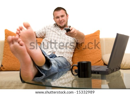 happy man on sofa with laptop