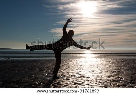 Happy Man on the seashore - stock photo