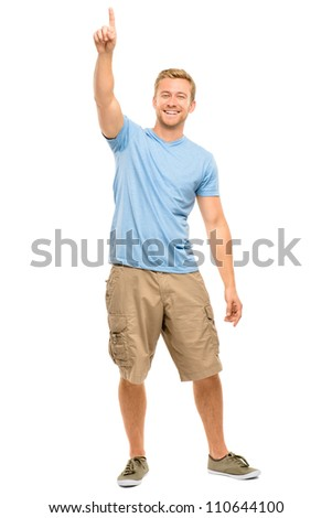 Happy man pointing - full length portrait on white background