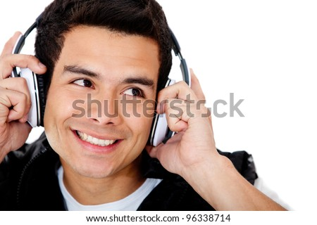 Happy man portrait with headphones - isolated over a white background