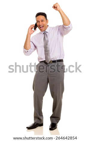 happy man receiving exciting news over the phone - stock photo
