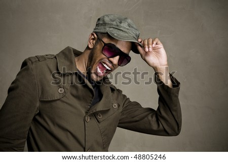 Happy man shows that he is in tune with the fashion scene - stock photo