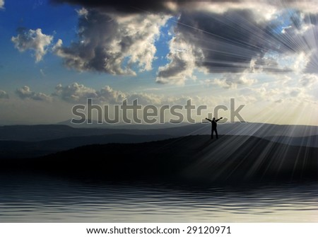 happy man silhouette on the mountains against beautiful sky - stock photo