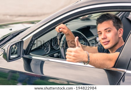 happy man sitting in his car - stock photo