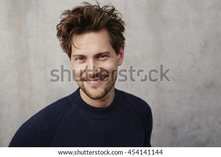 Happy man smiling at camera - stock photo