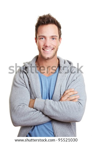 Happy man smiling with his arms crossed - stock photo