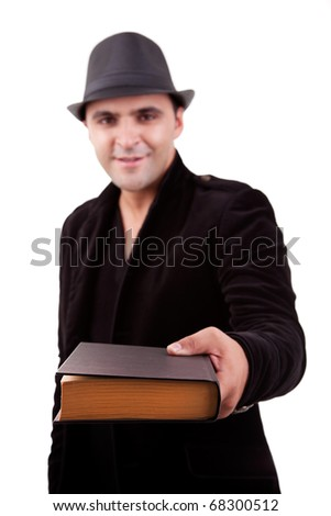 happy man standing  offering a book, isolated on white, studio shot - stock photo