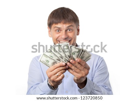 Happy man stretches out his arms with a pack of dollars. Business. Money.Bills.Dollar - stock photo
