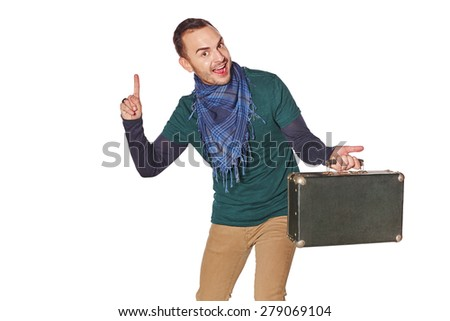 Happy man traveler with suitcase pointing finger up with idea, over white background - stock photo
