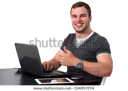 Happy man using pc and smiling while doing thumb up - stock photo