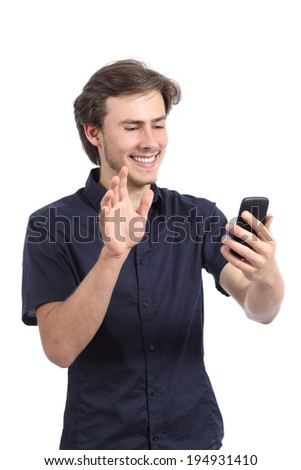 Happy man waving to a smart phone camera isolated on a white background - stock photo