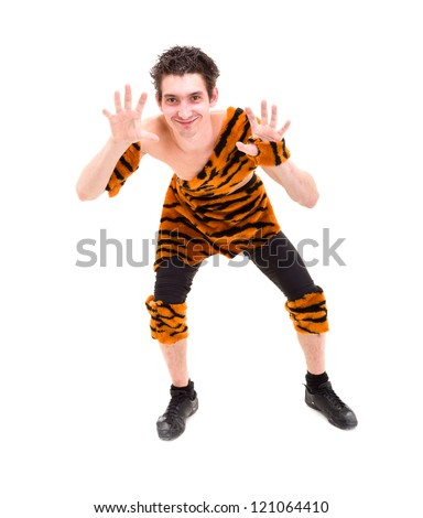 Happy man wearing a tiger skin posing against isolated white background - stock photo