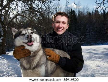 Happy man with a dog - stock photo