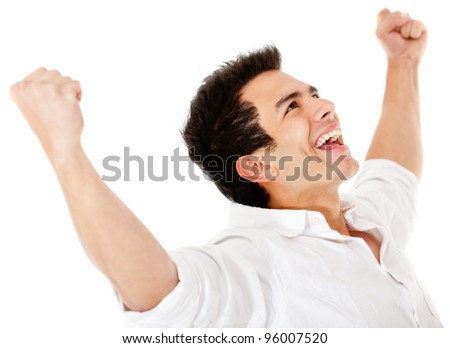 Happy man with arms up and smiling - isolated over a white background