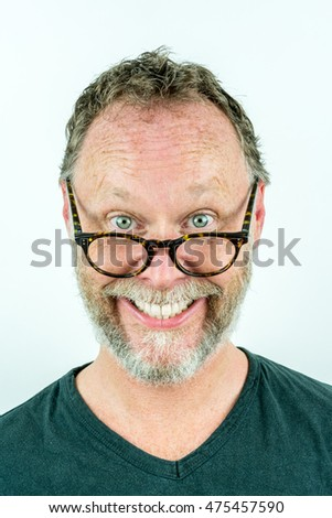 Happy man with beard and glasses laughing, funny portrait.