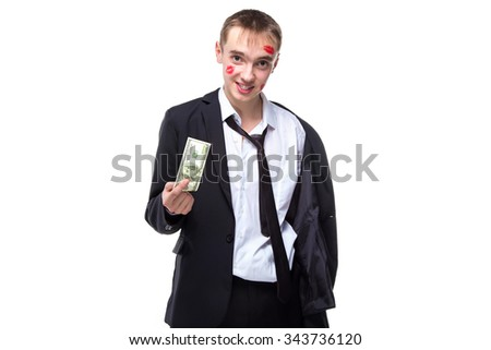 Happy man with dollars in kisses. Isolated photo of people with white background. - stock photo