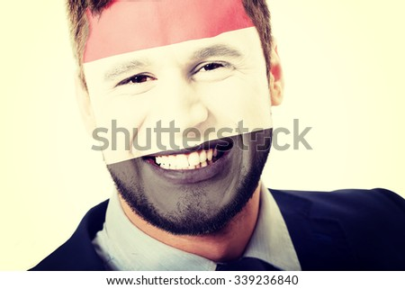 Happy man with Egypt flag painted on face.