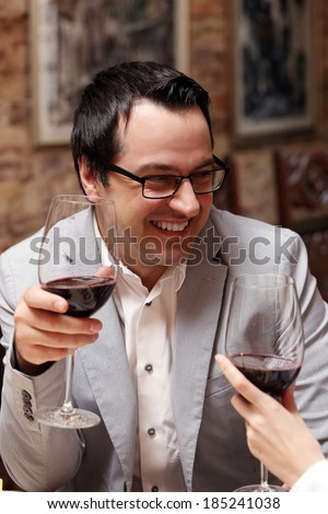 Happy man with glass of wine