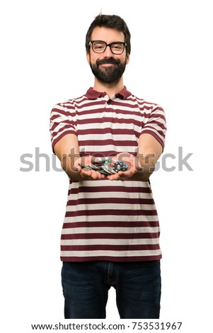 Happy Man with glasses holding poker chips