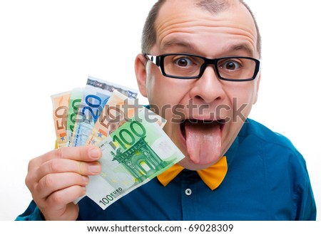 Happy man with handful of euro money isolated on white background - stock photo