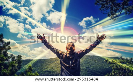 happy man with hands wide open in front of  beautiful landscape,with sun rays ,happy and joy ,enjoying life,Successful Man - stock photo