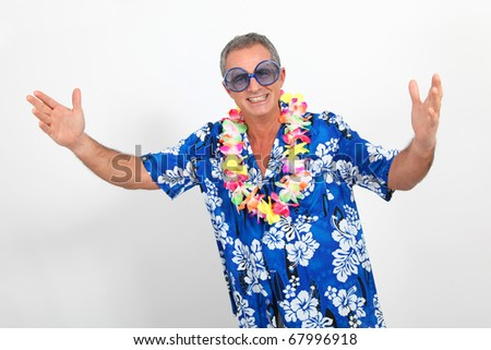 Happy man with hawaiian shirt - stock photo