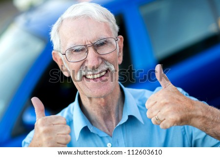 Happy man with his car and thumbs up - stock photo