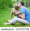 Happy man with his dog outdoors - stock photo