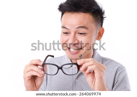 happy man with improved vision with eyeglasses