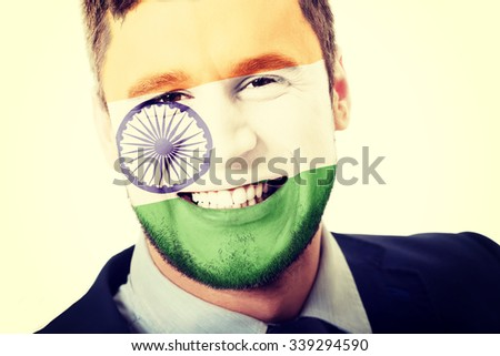 Happy man with India flag painted on face. - stock photo
